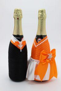 Украшение на шампанское жених и невеста оранжевое