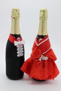 Украшение на шампанское жених и невеста красно-черное