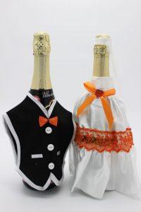 Украшение на шампанское жених и невеста белое с оранжевым