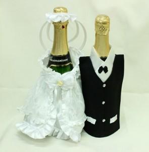 Украшение на свадебное шампанское белое и черное костюмы